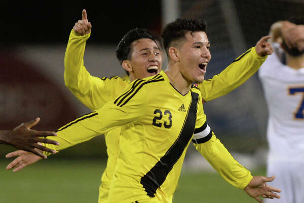 Manuel Flores (22) and Jose Guzman (23) of Wisdom celebrate a goal at the end of the second half of a boys bi-district soccer playoff game between the Elkins Knights and the Wisdom Panthers on Friday, March 24, 2017 at Hall Stadium, Missouri City, TX.