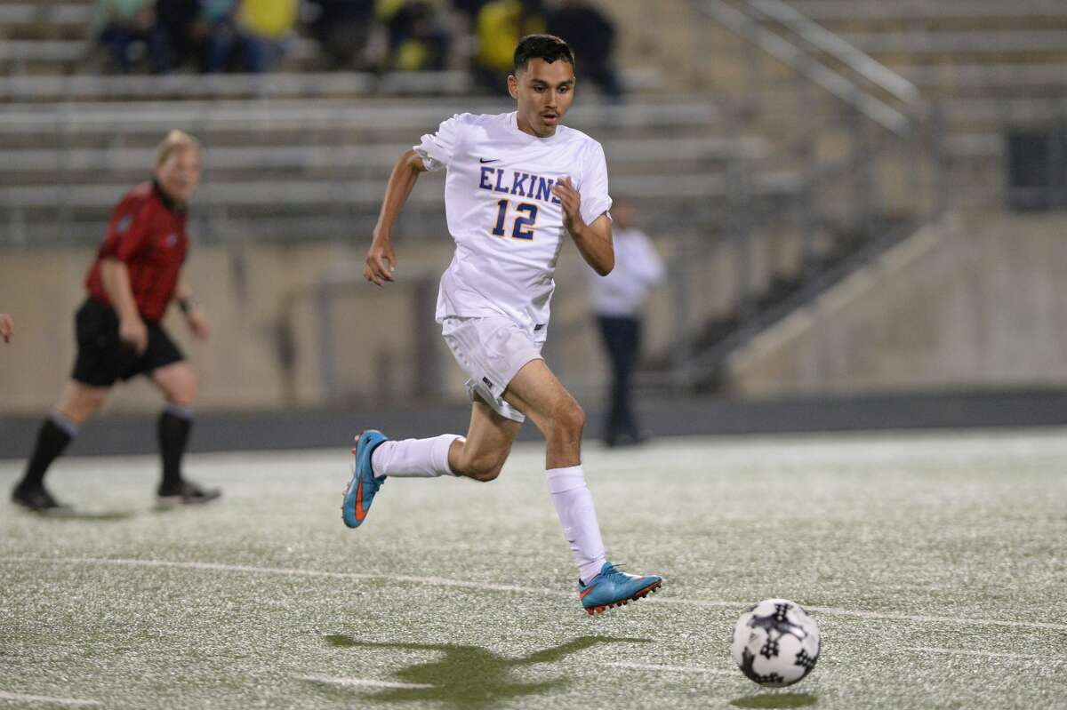 Anthony Garcia (12) of Elkins advances a ball during the first half of a boys bi-district soccer playoff game between the Elkins Knights and the Wisdom Panthers on Friday, March 24, 2017 at Hall Stadium, Missouri City, TX.