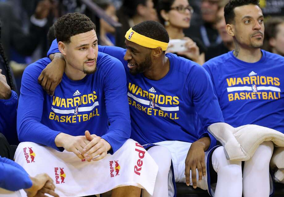 Klay Thompson, (left0 and Ian Clark share a moment as the Golden State Warriors went on to beat the Sacramento Kings 114-100 in NBA action at Oracle Arena in Oakland, Ca., on Fri. March 24, 2017. Photo: Michael Macor, The Chronicle