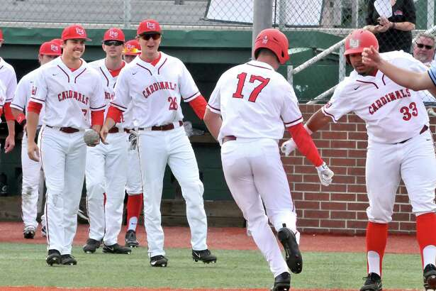 Lamar's Reid Russell, center, is congratulated by teammate Robin Adames, right, after hitting a home run in the bottom of the 5th inning, giving the Cardinals a 4-2 lead in their game with Incarnate Word on Friday at Vincent-Beck Stadium. (Mike Tobias/The Enterprise)