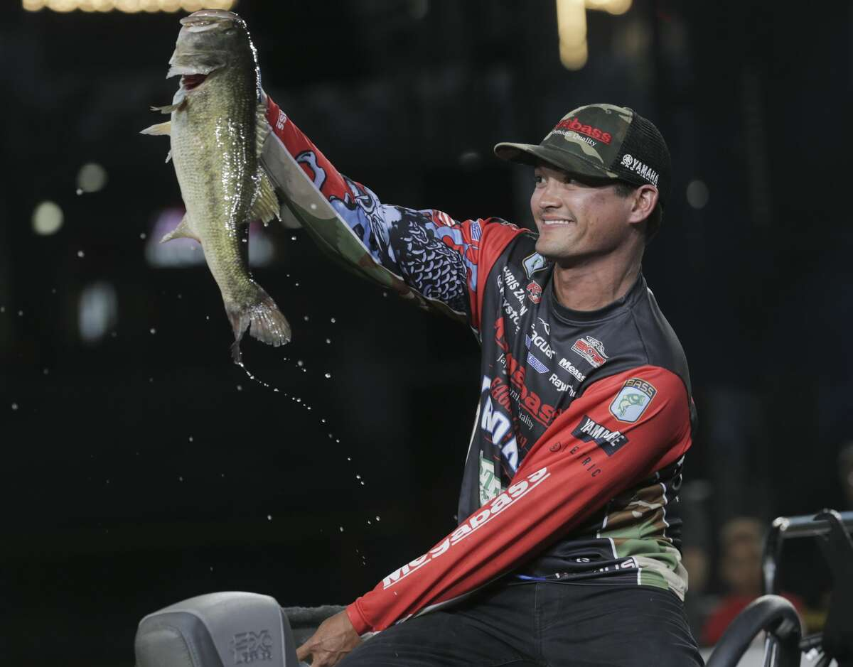 Chris Zaldain holds up a bass he caught during the 2017 GEICO Bassmaster Classic presented by DICK'S Sporting Goods at Minuet Maid Park on Friday, March 24, 2017, in Houston. ( Elizabeth Conley / Houston Chronicle )