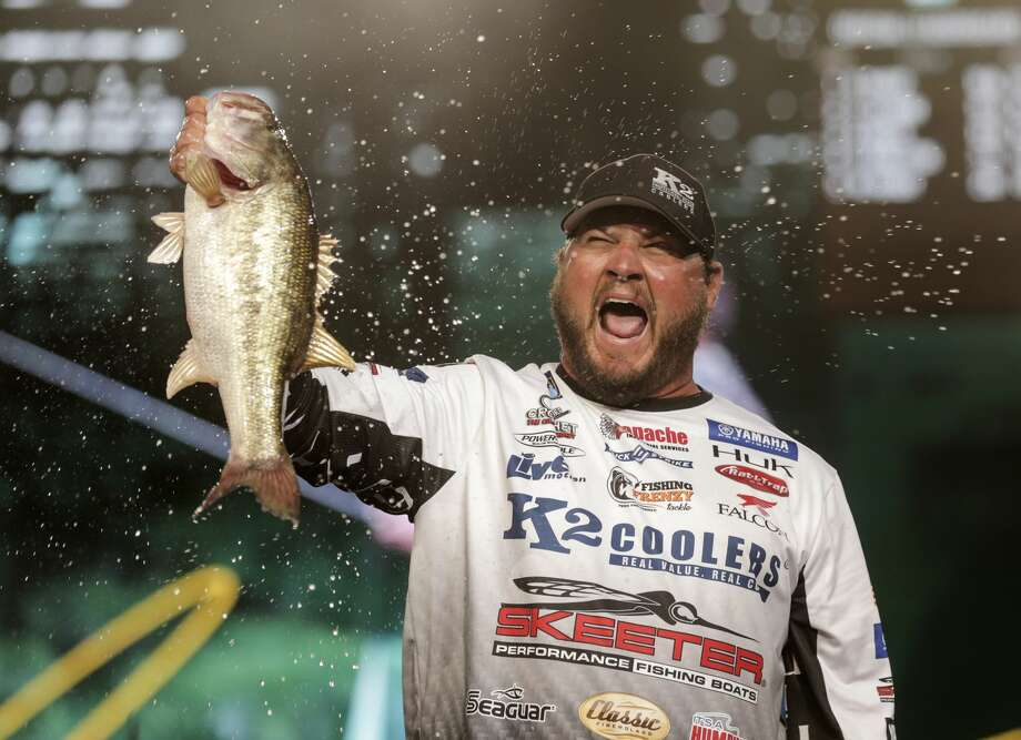 Cliff Rochet holds up a large bass he caught before weighing it in for the 2017 GEICO Bassmaster Classic presented by DICK'S Sporting Goods at Minuet Maid Park on Friday, March 24, 2017, in Houston. ( Elizabeth Conley / Houston Chronicle ) Photo: Elizabeth Conley/Houston Chronicle