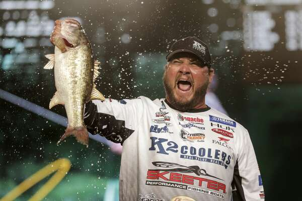 Cliff Rochet holds up a large bass he caught before weighing it in for the 2017 GEICO Bassmaster Classic presented by DICK'S Sporting Goods at Minuet Maid Park on Friday, March 24, 2017, in Houston. ( Elizabeth Conley / Houston Chronicle )