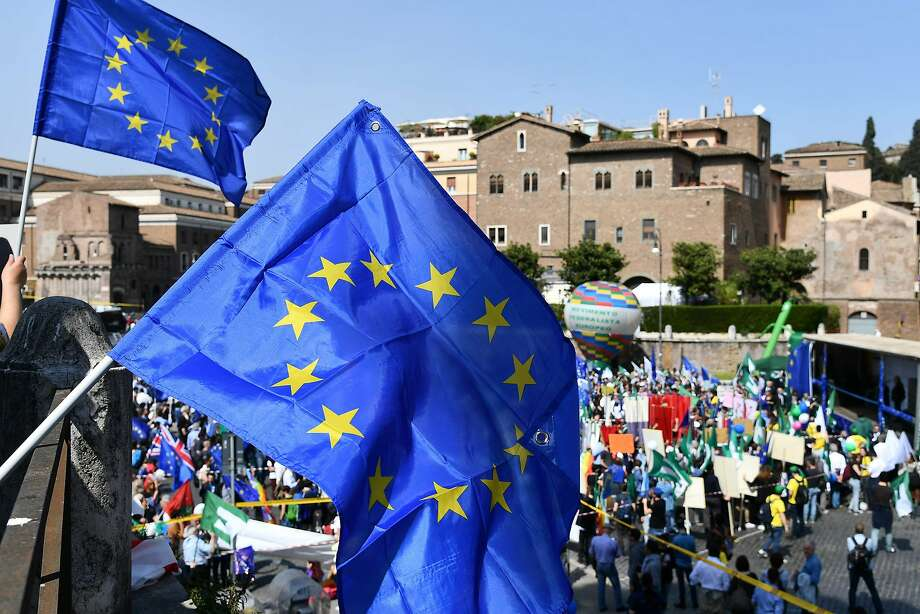 Pro-Europe demonstrators gather in Rome under European Union flags to express their support for the alliance. Photo: VINCENZO PINTO, AFP/Getty Images