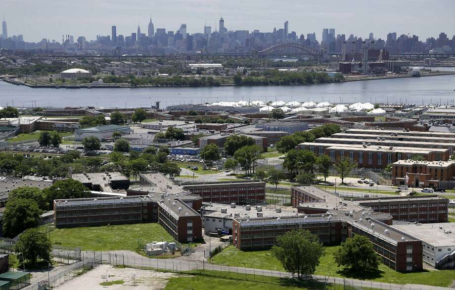 The Rikers Island jail complex occupies an island facility in New York City and is accessible only by a narrow bridge. Photo: Seth Wenig, Associated Press