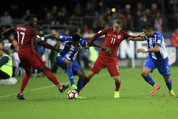 SAN JOSE, CA - MARCH 24:  Jozy Altidore #17 and Alejandro Bedoya #11 of the United States defend against Romell Quioto #7 and Romell Quioto #12 of Honduras  during their FIFA 2018 World Cup Qualifier at Avaya Stadium on March 24, 2017 in San Jose, California.