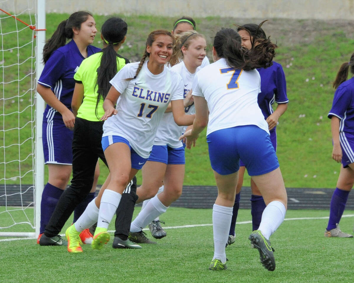 Narally Morales (17) and Josephine Henry (7) of Elkins celebrate a goal during the first half of a girls bi-district soccer playoff game between the Elkins Knights and the Northside Panthers on Friday, March 24, 2017 at Hall Stadium, Missouri City, TX.