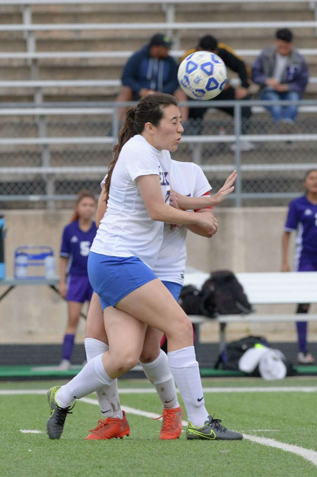 Josephine Henry (7) of Elkins heads a ball during the second half of a girls bi-district soccer playoff game between the Elkins Knights and the Northside Panthers on Friday, March 24, 2017 at Hall Stadium, Missouri City, TX.