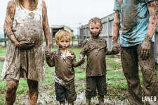 The Bartons play in the mud for an adorable maternity shoot after rain hampered their original plans.