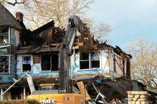 John Buzzeo, project manager of Norwalk's AMEC Carting, testified he filled out a demolition application for Dec. 28, 2011 after his company already took down the Shippan Avenue home where five people died on Christmas Day 2011.