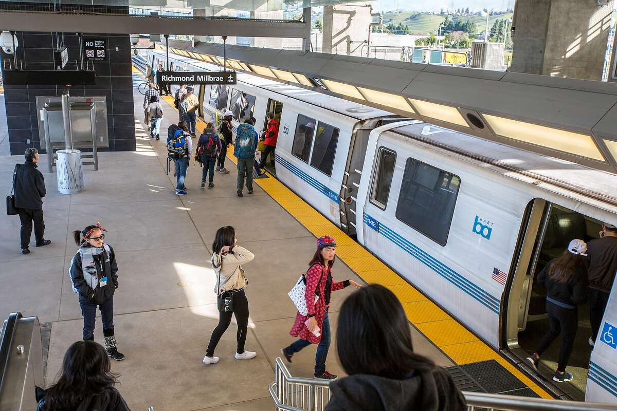 FILE - Riders and the Warm Springs BART station on first day of service, Saturday, March 25, 2017 in Fremont, CA. The new station will be just north of this one.