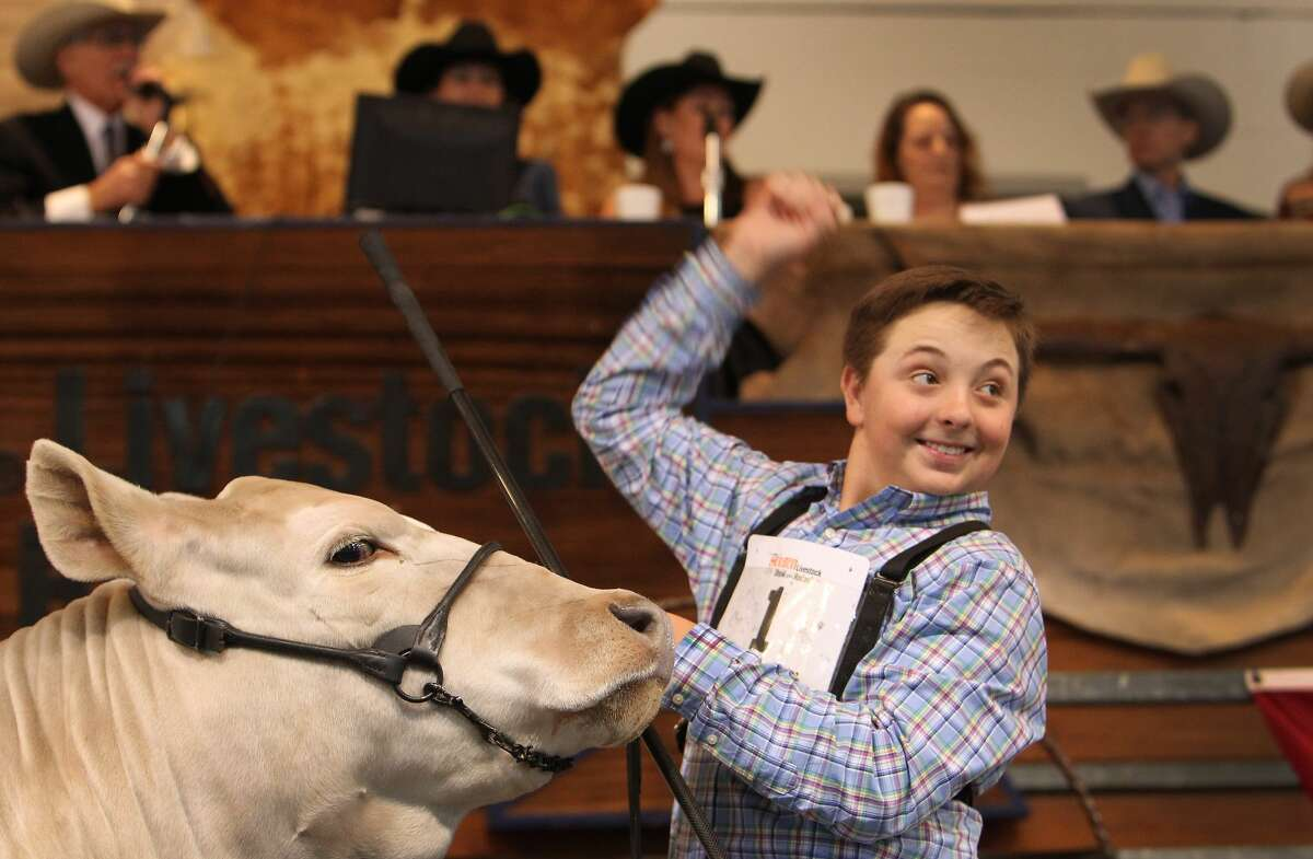 Jagger Horn, of Anson, Texas, reacts to the winning bid on