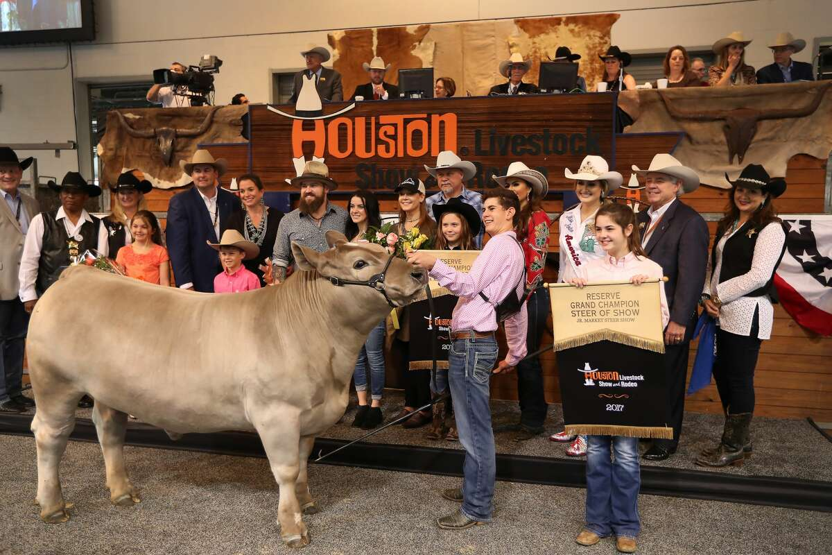 Musician Zach Brown (center) and his wife Shelly along with others pose with Stock Martin, Hereford, TX and his Reserve Grand Champion Steer during the Junior Market Steer Auction in NRG Arena Sales Pavilion Saturday, March 25, 2017, in Houston. ( Steve Gonzales / Houston Chronicle )