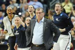 UConn Huskies head coach Geno Auriemma looks on after his team scores in the 2017 NCAA Division I Women's Basketball Championship Regional Semifinal game between No. 1 UConn and No. 4 UCLA at Webster Bank Arena in Bridgeport, Conn. Saturday, March 25, 2017.
