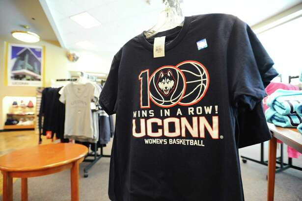 A 100 wins in a row women's basketball T-shirt sits at the front of the UConn Stamford gift shop in Stamford, Conn. on Thursday, March 23, 2017.