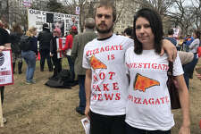 """I don't have any doubt that Pizzagate is real,"" says Kori Hayes, shown with wife Danielle Hayes at a ""PizzaGate"" protest outside the White House on March 25, 2017."