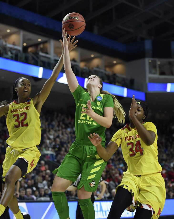 Oregon's Sabrina Ionescu shoots between Maryland's Shatori Walker-Kimbrough, left, and Maryland's Brianna Fraser, right, during the second half of a regional semifinal game in the NCAA women's college basketball tournament, Saturday, March 25, 2017, in Bridgeport, Conn. (AP Photo/Jessica Hill) Photo: Jessica Hill / Associated Press / AP2017