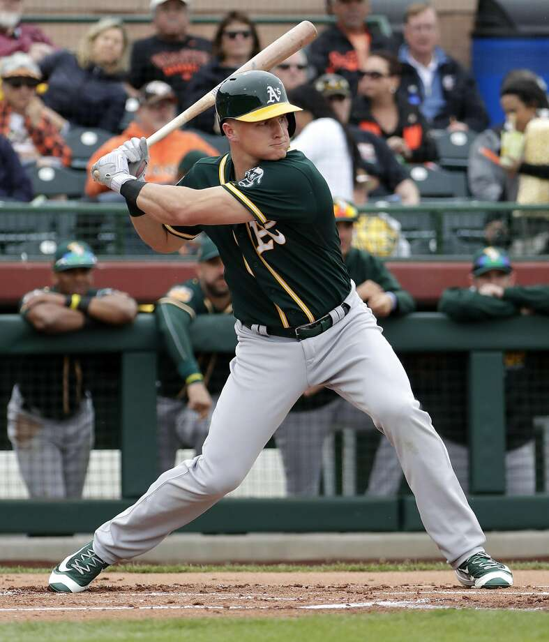 Oakland Athletics' Matt Chapman hits against the San Francisco Giants during the first inning of a spring training baseball game, Monday, Feb. 27, 2017, in Scottsdale, Ariz. (AP Photo/Matt York) Photo: Matt York, Associated Press