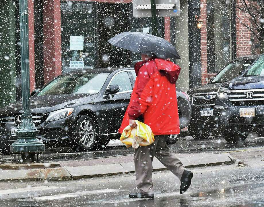 Winter stays long in the north country as a spring snow squall makes crossing the street an adventure Saturday March 25, 2017 in Glens Falls, NY. (John Carl D'Annibale / Times Union) Photo: John Carl D'Annibale