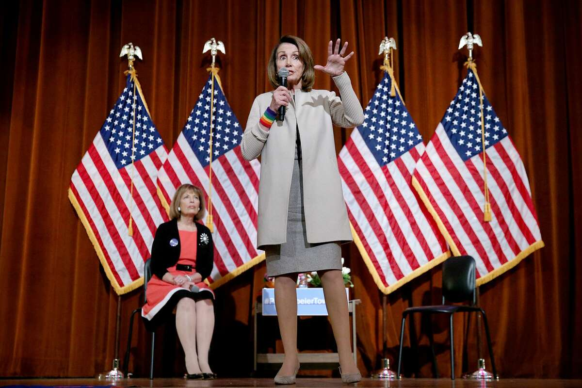 Nancy Pelosi (standing) and Jackie Speier hold a town hall meeting at Balboa High School on Saturday, March 25, 2017, in San Francisco, Calif.
