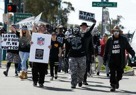 About 50 dedicated Oakland Raiders fans begin a march on 66th Avenue past the Coliseum after Mayor Libby Schaaf provided details of a last minute stadium plan at a news conference in Oakland, Calif. on Saturday, March 25, 2017, hoping to convince NFL owners to reject a proposed relocation of the Raiders to Las Vegas.