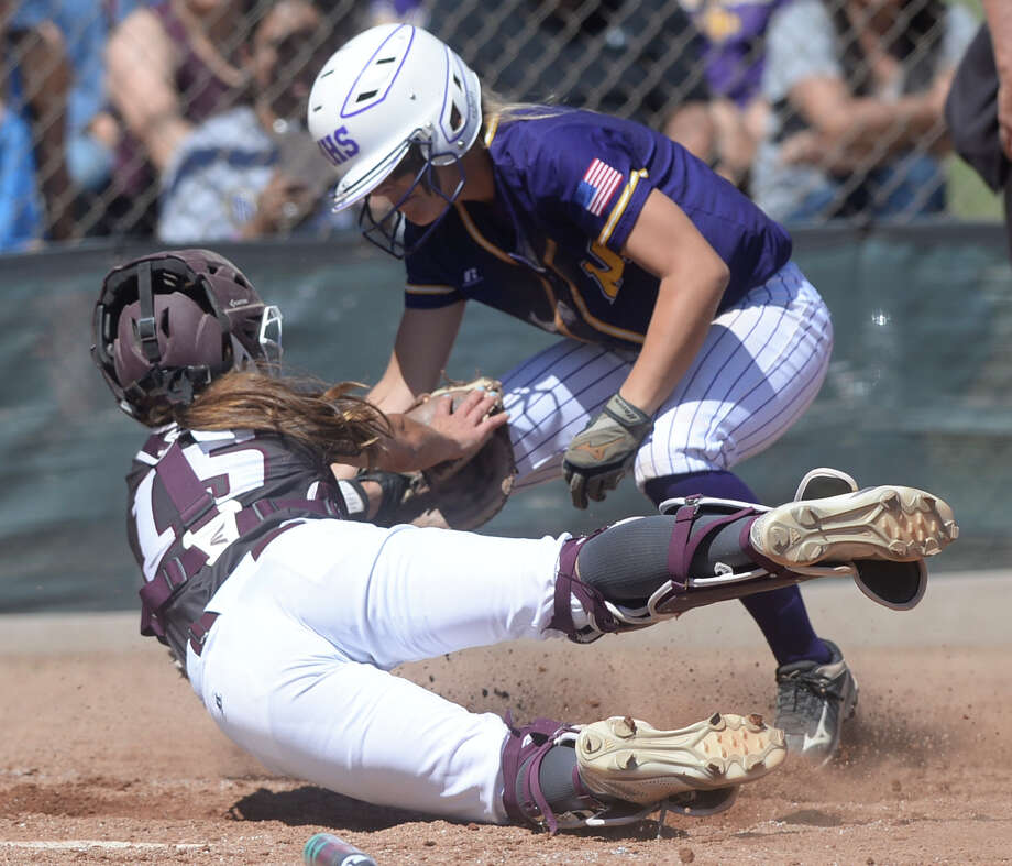 Lee catcher Baylee Leonard (15) gets Midland High's Ashley McClellan (14) out at home plate on March 25, 2017, at Audrey Gill Sports Complex. James Durbin/Reporter-Telegram Photo: James Durbin