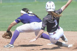 Midland High's Abbi Sanchez (5) gets an out at second base against Lee's Shay Maddy (1) on March 25, 2017, at Audrey Gill Sports Complex. James Durbin/Reporter-Telegram