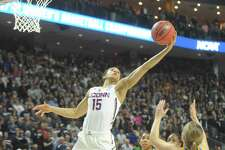 UConn's Gabby William's skies for a rebound in the Huskies' win over UCLA at Webster Bank Arena.