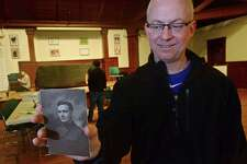 Norwalk resident Chris O'Connor holds a photo of his grandfather, William O'Connor, who served in Europe during the Connecticut State Library's Remembering World War One project Digitization Day Saturday, March 25, 2017, at the Pequot Library in Fairfield, Conn. This year marks the 100th Anniversary of the United State's entry into World War One. In an effort to help preserve this significant part of history Connecticut State Library partnered with The Pequot Library and The Fairfield Museum and History Center for the event. The Remembering World War One project is funded by a grant from the National Endowment for the Humanities and canvases the state digitizing old photos, documents, mementos, and other objects related to the war at home and abroad.