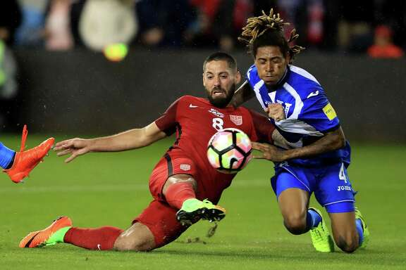 SAN JOSE, CA - MARCH 24:  Clint Dempsey #8 of the United States scores a goal as Henry Figueroa #4 of Honduras defends during their FIFA 2018 World Cup Qualifier at Avaya Stadium on March 24, 2017 in San Jose, California.  (Photo by Sean M. Haffey/Getty Images)