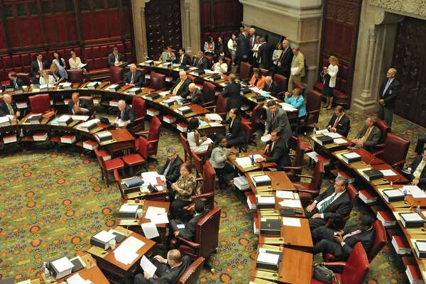 Senators vote during session in the Senate chamber at the New York State Capitol on Wednesday, June 24, 2015 in Albany, N.Y. (Lori Van Buren / Times Union)