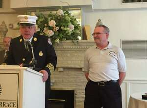 Troy Fire Chief Thomas Garrett speaks about retiring dispatcher Steve Schongar who began his career as a city fire dispatcher 38 years ago. (Kenneth C. Crowe II / Times Union)