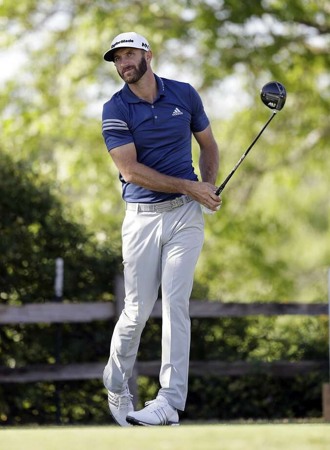 No. 1 Dustin Johnson watches his tee shot soar during another excellent Match Play round. Photo: Eric Gay, Associated Press