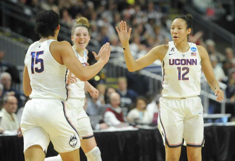 UConn teammates Gabby Williams (15), Katie Lou Samuelson (33), and Saniya Chong (12) celebrate during No. 1 UConn's 86-71 win over No. 4 UCLA in the 2017 NCAA Division I Women's Basketball Championship Regional Semifinal game at Webster Bank Arena in Bridgeport, Conn. Saturday, March 25, 2017. Photo: Tyler Sizemore / Hearst Connecticut Media / Greenwich Time
