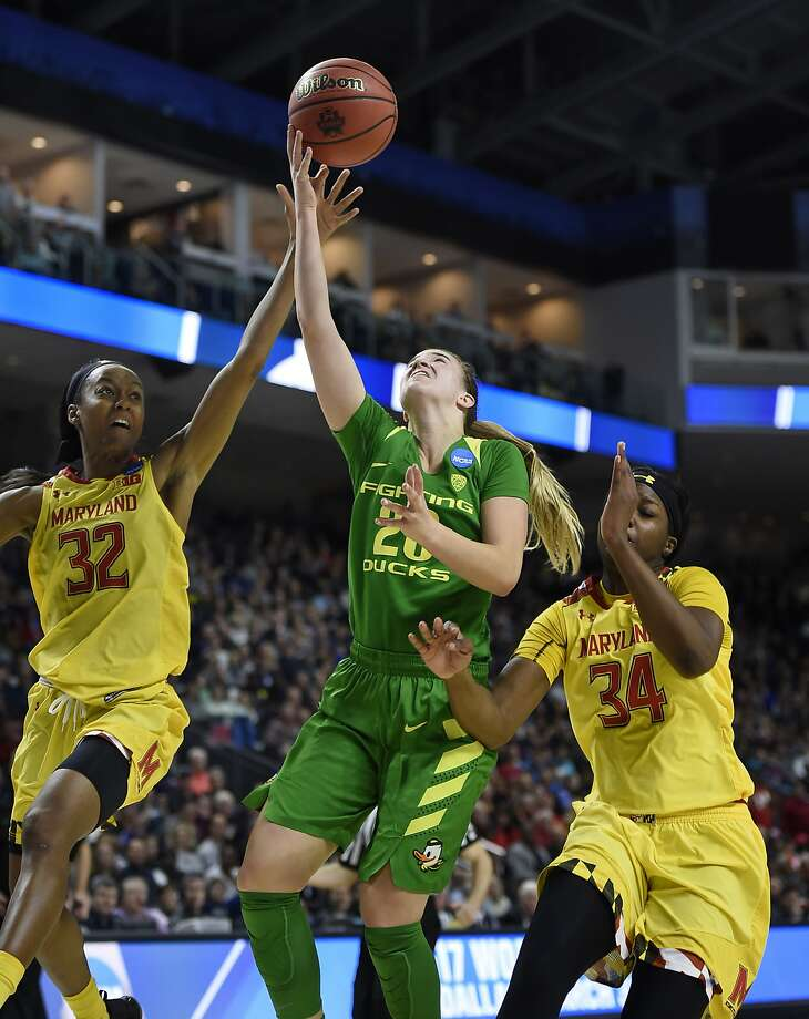 Miramonte-High graduate Sabrina Ionescu of Oregon shoots between Maryland's Shatori Walker-Kimbrough and Brianna Fraser on her way to 21 points, seven assists and six rebounds. Photo: Jessica Hill, Associated Press