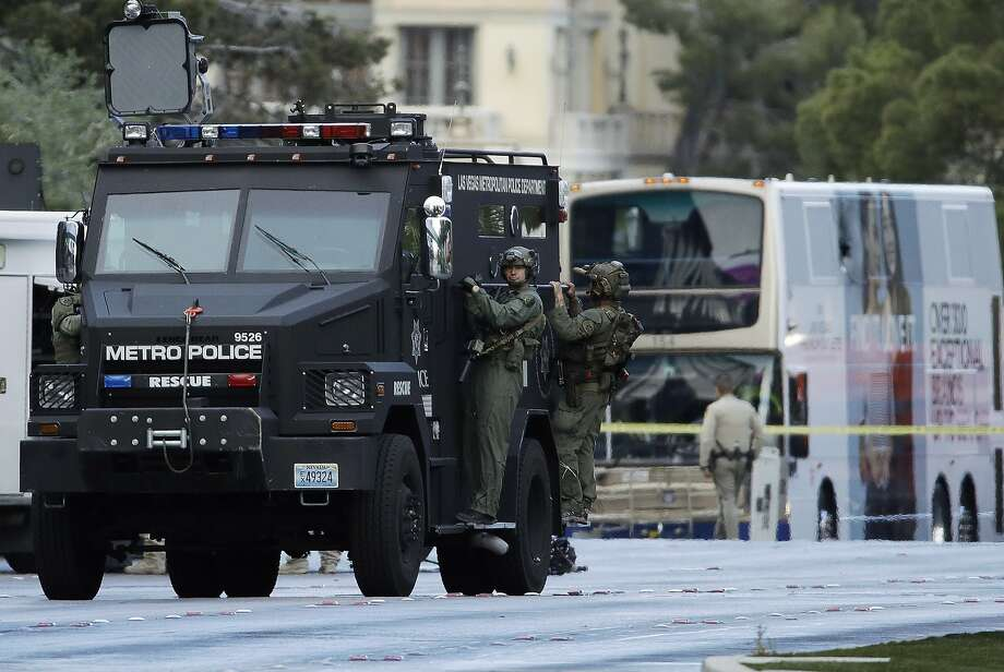 SWAT officers leave the scene of a standoff with a gunman who had barricaded himself in a bus on Las Vegas Boulevard. Photo: John Locher, Associated Press