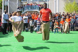 Kevin Hart participates in the sack race at Rally HealthFest in San Francisco on Saturday, March 25.