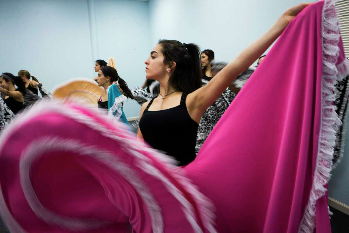 Paula Urdaneta dances to Venezuelan folk music at Danmar Art and Dance Studio, which teaches traditional dances like the flamenco, in Katy.