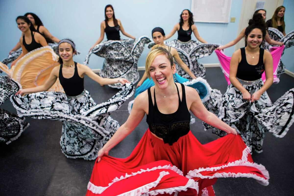 """Maria Fernanda Urbaez, 33, artistic director and choreographer at Danmar Art and Dance Studio, is a Venezuelan-American living in Texas since 1998 when her parents, both engineers, got oil industry jobs in Texas. """"Our dance studio helps Venezuelans to hold on to their roots, and it also shows their roots to other people,"""" Maria Romero Urbaez said."""