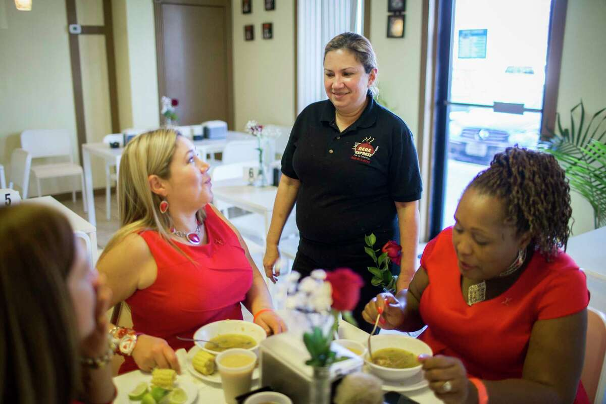 Nereida Delgado, owner of Nere Express, stops to talk to diners, from left, Margarita Gonzalez, Veve Hay and Lisa Swift. Nere Express is one of five Venezuelan restaurants in the Katy area.