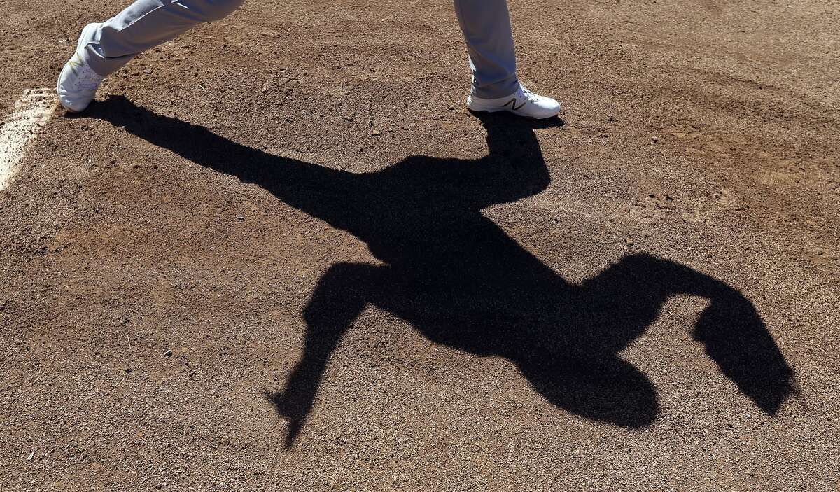 A's starter Sonny Gray warms up before a spring training game in Scottsdale, Ariz., on March 7.