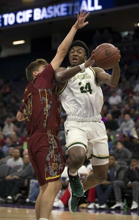 Kyree Walker (right) helped Moreau Catholic reach the state Division II title game, but will transfer to an Arizona school. Photo: D. Ross Cameron, Special To The Chronicle