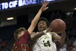 Moreau Catholic's Kyree Walker (24) goes up for a shot against Esperanza's Garrett Poling (44) during the first quarter of their CIF Boys Division II high school state championship basketball game, Saturday, March 25, 2017 in Sacramento, Calif. Mission won in overtime 82-75.