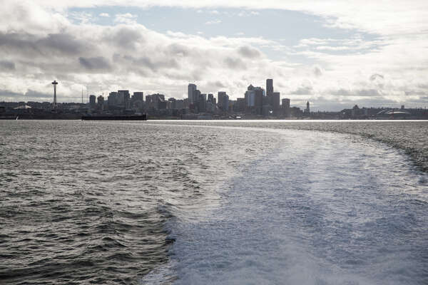 The Seattle skyline rises from Elliott Bay while aboard the San Juan Clipper on Saturday, March 25, 2017.
