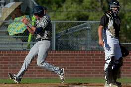 Luke Trahan (7) of College Park celebrates as he scores a run off a bunt by Josh Trahan during the seventh inning of a District 12-6A high school baseball game at Elmore Field on Saturday, March 25, 2017, in Conroe. College Park defeated Conroe 3-2.