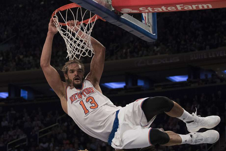 New York Knicks center Joakim Noah hangs from the basket after attempting a dunk during the first half of a preseason NBA basketball game against the Boston Celtics, Saturday, Oct. 15, 2016, at Madison Square Garden in New York. (AP Photo/Mary Altaffer) Photo: Mary Altaffer, Associated Press