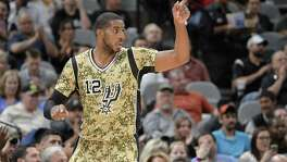 San Antonio Spurs forward LaMarcus Aldridge celebrates a basket during the second half of an NBA basketball game against the Memphis Grizzlies, Thursday, March 23, 2017, in San Antonio. San Antonio won 97-90. Aldridge scored his 15,000th NBA point during the game. (AP Photo/Darren Abate)