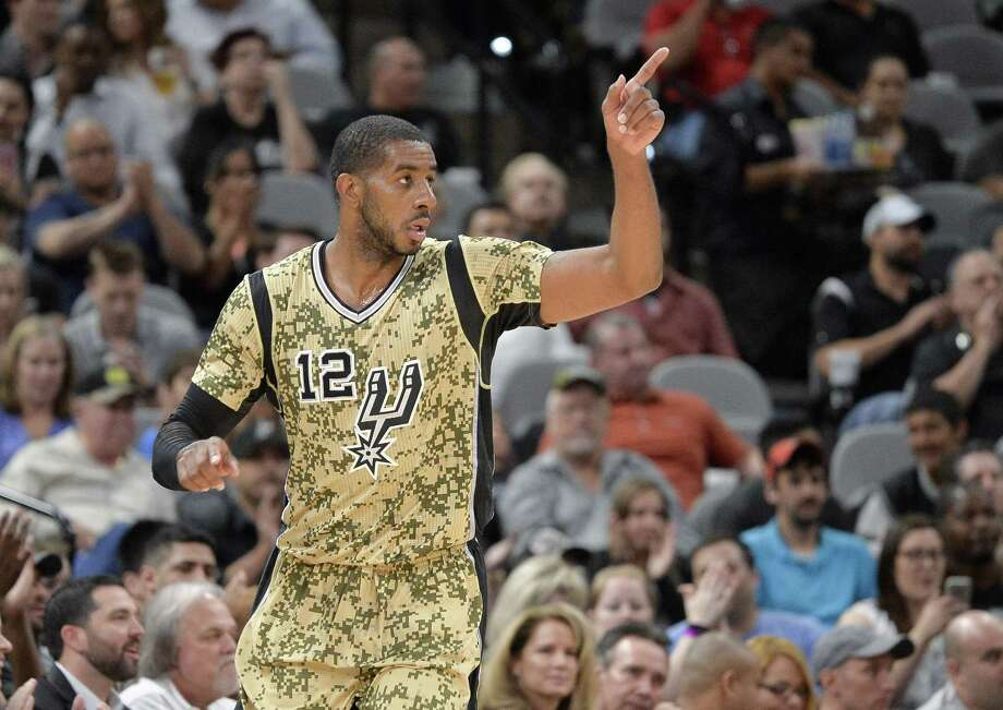 San Antonio Spurs forward LaMarcus Aldridge celebrates a basket during the second half of an NBA basketball game against the Memphis Grizzlies, Thursday, March 23, 2017, in San Antonio. San Antonio won 97-90. Aldridge scored his 15,000th NBA point during the game. (AP Photo/Darren Abate) Photo: Darren Abate, FRE / Associated Press / FR115 AP