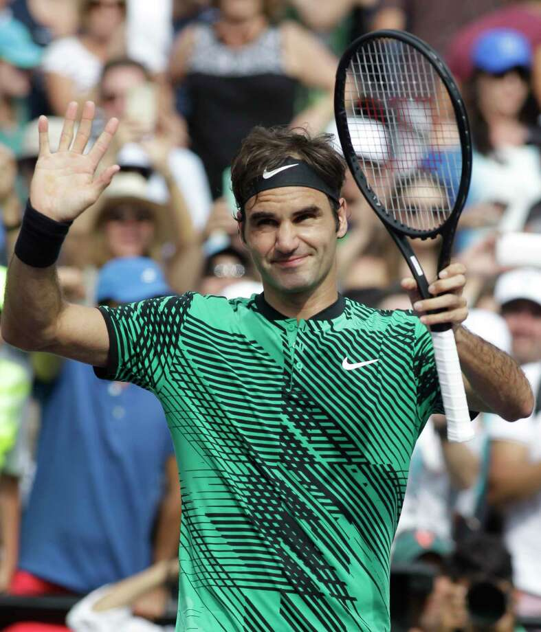 Roger Federer, of Switzerland, waves to the crowd after defeating Frances Tiafoe during the Miami Open tennis tournament, Saturday, March 25, 2017, in Key Biscayne, Fla. (AP Photo/Luis M. Alvarez) ORG XMIT: FLLA201 Photo: Luis M. Alvarez / FR596 AP