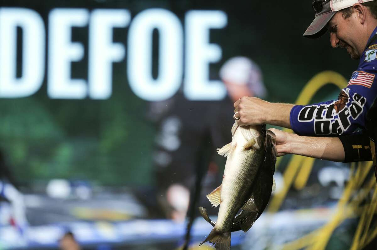 Otto DeFoe takes out two bass to show off before heading to the scale to weigh in for day two of the Bassmaster Classic on Saturday, March 25, 2017, in Houston. DeFoe ended the day in 10th place. ( Elizabeth Conley / Houston Chronicle )
